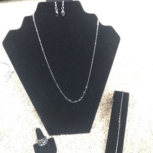 Necklace, bracelet, earrings, and ring